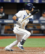 Tampa Bay Rays' Kevin Kiermaier hits a two-run single off New York Yankees reliever Nestor Cortes Jr. during the seventh inning of a baseball game Friday, July 5, 2019, in St. Petersburg, Fla. (AP Photo/Steve Nesius)