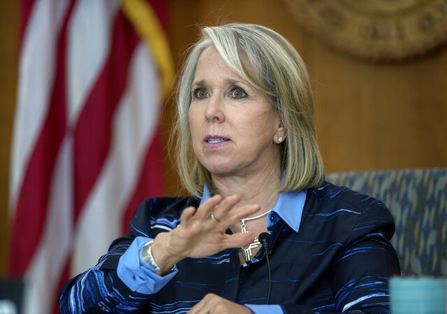 New Mexico Gov. Michelle Lujan Grisham gives her weekly update on COVID-19 in New Mexico and the state's effort to contain it during a virtual news conference from the state Capitol in Santa Fe, N.M., on Thursday, July 23, 2020. (Eddie Moore/The Albuquerque Journal via AP)