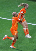 Netherlands' Jackie Groenen, right, celebrates with her teammate Shanice Van De Sanden after scoring her side's opening goal during the Women's World Cup semifinal soccer match between the Netherlands and Sweden, at the Stade de Lyon outside Lyon, France, Wednesday, July 3, 2019. (AP Photo/Francois Mori)