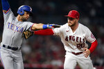 Los Angeles Angels first baseman Jared Walsh, right, tags out Texas Rangers' Jason Martin along the first base line after a ground ball during the seventh inning of a baseball game Monday, Sept. 6, 2021, in Anaheim, Calif. (AP Photo/Marcio Jose Sanchez)