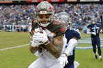 Tampa Bay Buccaneers wide receiver Mike Evans (13) catches a touchdown pass ahead of Tennessee Titans cornerback LeShaun Sims (36) in the first half of an NFL football game Sunday, Oct. 27, 2019, in Nashville, Tenn. (AP Photo/Mark Zaleski)