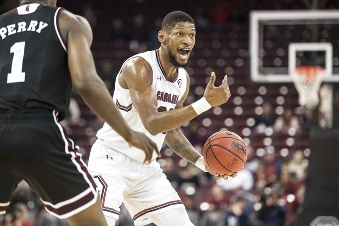 South Carolina forward Chris Silva (30) communicates with teammates during the first half of the team's NCAA college basketball game against Mississippi State on Tuesday, Jan. 8, 2019, in Columbia, S.C. (AP Photo/Sean Rayford)