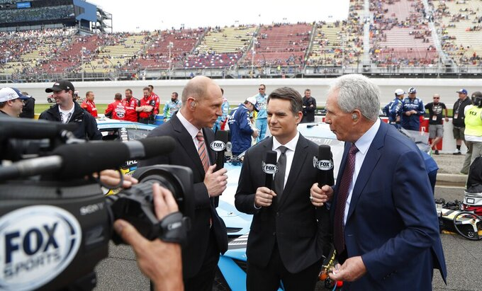 Fox Sports broadcasters Adam Alexander, left, Jeff Gordon and Darrell Waltrip on pit row before the NASCAR cup series auto race at Michigan International Speedway, Sunday, June 9, 2019, in Brooklyn, Mich. (AP Photo/Carlos Osorio)