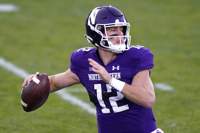 Northwestern quarterback Peyton Ramsey throws a pass during the first half of an NCAA college football game against Wisconsin in Evanston, Ill., Saturday, Nov. 21, 2020. (AP Photo/Nam Y. Huh)