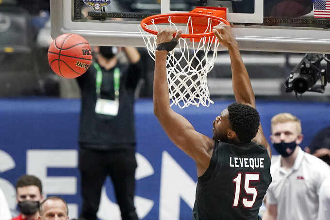 South Carolina's Wildens Leveque (15) scores against Mississippi in the first half of an NCAA college basketball game in the Southeastern Conference Tournament Thursday, March 11, 2021, in Nashville, Tenn. (AP Photo/Mark Humphrey)