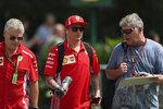 Ferrari driver Kimi Raikkonen of Finland, center, arrives at the Marina Bay City Circuit ahead of the Singapore Formula One Grand Prix in Singapore, Friday, Sept. 14, 2018. (AP Photo/Yong Teck Lim)