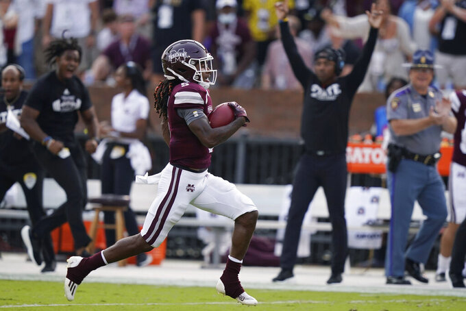 Mississippi State wide receiver Lideatrick Griffin (5) scores a touchdown on a 100-yard kickoff return against North Carolina State during the first half of an NCAA college football game in Starkville, Miss., Saturday, Sept. 11, 2021. (AP Photo/Rogelio V. Solis)