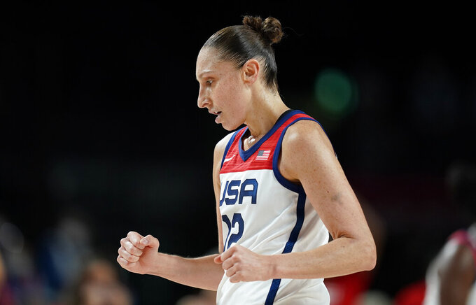 United States' Diana Taurasi (12) celebrates during women's basketball gold medal game against Japan at the 2020 Summer Olympics, Sunday, Aug. 8, 2021, in Saitama, Japan. (AP Photo/Charlie Neibergall)