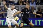 Colorado Rapids defender Tommy Smith, left, and Sporting Kansas City forward Krisztian Nemeth chase the ball during the first half of an MLS soccer match, Saturday, Sept. 21, 2019, in Kansas City, Kan. (AP Photo/Charlie Riedel)
