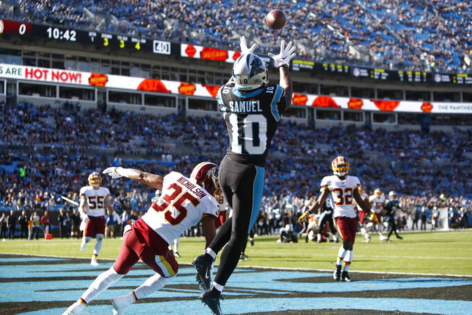 Carolina Panthers wide receiver Curtis Samuel (10) catches a touchdown pass while Washington Redskins free safety Montae Nicholson (35) defends during the first half of an NFL football game in Charlotte, N.C., Sunday, Dec. 1, 2019. (AP Photo/Brian Blanco)