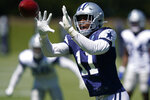Dallas Cowboys linebacker Micah Parsons (11) reaches for the ball during NFL football practice in Frisco, Texas, Tuesday, Aug. 24, 2021. (AP Photo/LM Otero)
