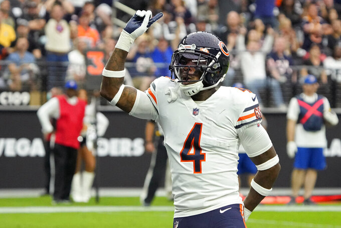 Chicago Bears free safety Eddie Jackson (4) celebrates after a play against the Las Vegas Raiders during the first half of an NFL football game, Sunday, Oct. 10, 2021, in Las Vegas. (AP Photo/Rick Scuteri)