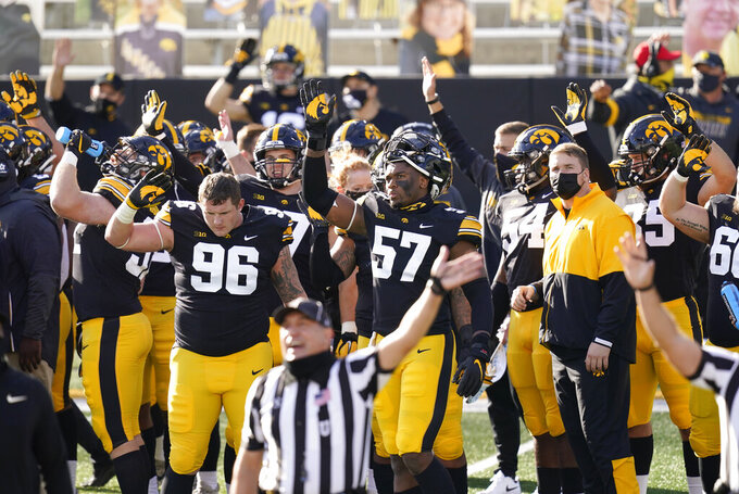 Iowa players wave to children in the University of Iowa Stead Family Children's Hospital at the end of the first quarter of an NCAA college football game against Northwestern, Saturday, Oct. 31, 2020, in Iowa City, Iowa. (AP Photo/Charlie Neibergall)