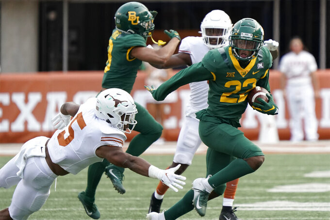 Baylor's Davis Baucum (23) runs past Texas' D'Shawn Jamison (5) during the second half of an NCAA college football game in Austin, Texas, Saturday, Oct. 24, 2020. (AP Photo/Chuck Burton)
