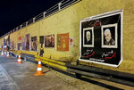 FILE - This Thursday, Jan. 16, 2020 file photo, posters of Iranian General Qassem Soleimani and deputy commander of Iran-backed militias Abu Mahdi al-Muhandis, both killed in a U.S. strike earlier this month, hang on the walls at the site where they were killed in Baghdad, Iraq. The Islamic State group seemed largely defeated last year, with the loss of its territory, the killing of its founder in a U.S. raid and an unprecedented crackdown on its social media propaganda machine but tensions between the U.S. and Iran in the region provide a comeback opportunity for the extremist group. (AP Photo/Hadi Mizban, File)