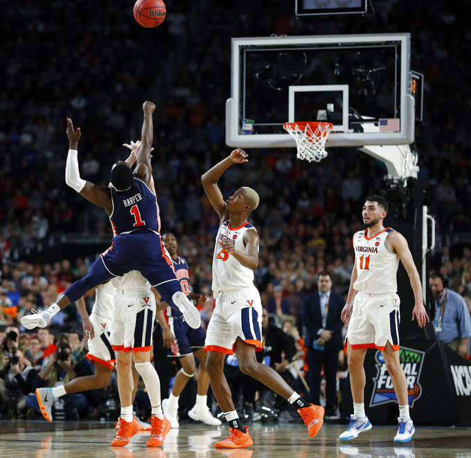 Auburn's Jared Harper (1) shoots against Virginia's Kyle Guy during the first half in the semifinals of the Final Four NCAA college basketball tournament, Saturday, April 6, 2019, in Minneapolis. (AP Photo/Jeff Roberson)