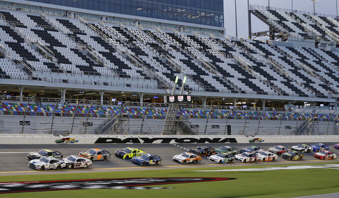 Chase Briscoe leads the field to start a NASCAR Xfinity auto race at Daytona International Speedway, Friday, Aug. 28, 2020, in Daytona Beach, Fla. (AP Photo/Terry Renna)