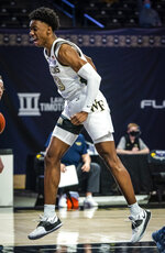 Wake Forest guard Quadry Adams (13) celebrates a dunk against Georgia Tech during an NCAA college basketball game Friday, March 5, 2021, in Winston-Salem, N.C. (Andrew Dye/The Winston-Salem Journal via AP)