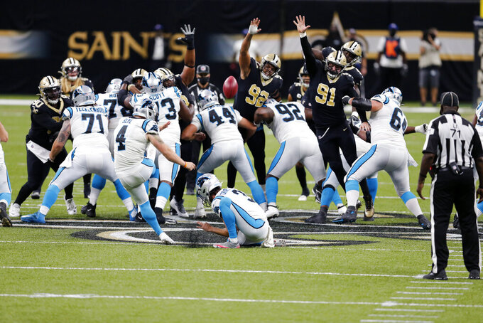 Carolina Panthers kicker Joey Slye (4) kicks but misses a 65 yard field goal attempt which would have tied the game, in the second half of an NFL football game against the New Orleans Saints in New Orleans, Sunday, Oct. 25, 2020. (AP Photo/Brett Duke)