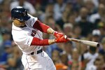 Boston Red Sox's Mookie Betts follows through on a two-run single during the fifth inning of the team's baseball game against the Toronto Blue Jays in Boston, Tuesday, July 16, 2019. (AP Photo/Michael Dwyer)