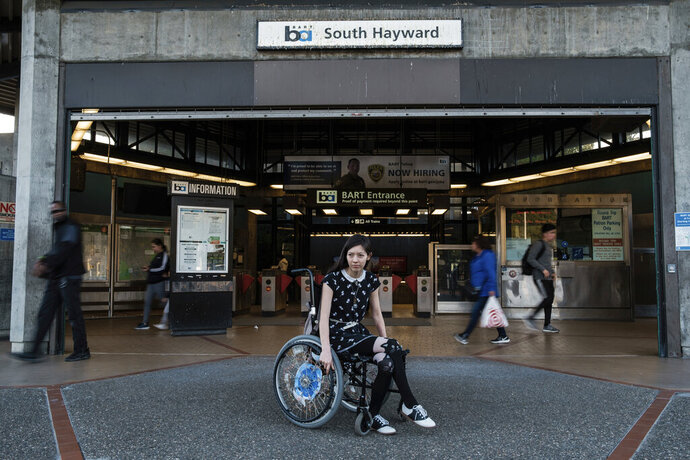 In this Thursday, Nov. 21, 2019 photo, Sophia Humphrey poses for a portrait at the South Hayward Bart Station in Hayward, Calif. Humphrey witnessed the killing of a good Samaritan on a San Francisco Bay Area commuter train. (Nick Otto/San Francisco Chronicle via AP)