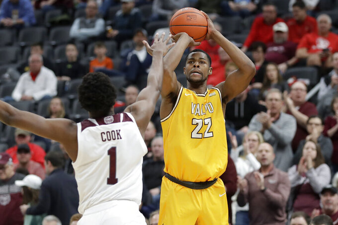 Valparaiso's Mileek McMillan (22) shoots over Missouri State's Keandre Cook (1) during the first half of an NCAA college basketball game in the semifinal round of the Missouri Valley Conference men's tournament Saturday, March 7, 2020, in St. Louis. (AP Photo/Jeff Roberson)