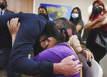 California Gov. Gavin Newsom, left, hugs Lorenza Cortez Barrera, right, as he leaves after speaking to her and other former farmworkers at Clinica Sierra Vista, Tuesday, July 27, 2021, in Fresno, Calif. Barrera is blind and relies on her husband for home care. Older Californians who are living in the country without permission are newly eligible for state health care coverage under legislation signed by Newsom Tuesday. (Eric Paul Zamora/The Fresno Bee via AP)