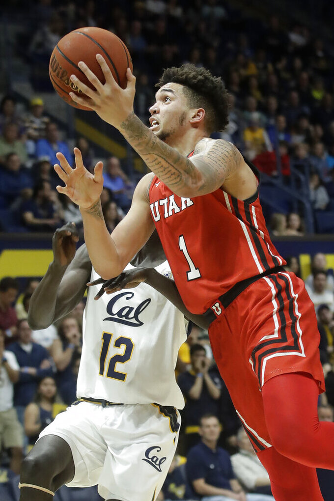 FILE - Utah forward Timmy Allen (1) shoots against California forward Kuany Kuany (12) during the first half of an NCAA college basketball game in Berkeley, Calif., in this Saturday, Feb. 29, 2020, file photo. Four starters return to Utah from a year ago – led by second-team All-Pac-12 selection Timmy Allen. (AP Photo/Jeff Chiu, File)
