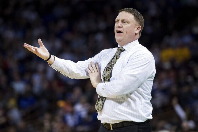VCU coach Mike Rhoades talks with an official during the first half of a first-round game against Central Florida in the NCAA men's college basketball tournament Friday, March 22, 2019, in Columbia, S.C. (AP Photo/Sean Rayford)