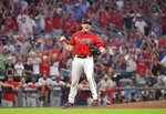 Atlanta Braves relief pitcher Mark Melancon reacts after he struck out St. Louis Cardinal' Kolten Wong to end Game 2 of a baseball National League Division Series on Friday, Oct. 4, 2019, in Atlanta. The Braves won 3-0. (Hyosub ShinAtlanta Journal-Constitution via AP)