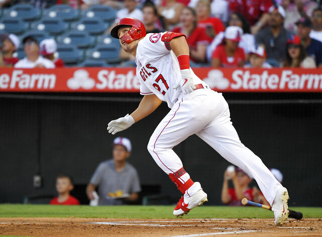 FILE - In this July 27, 2019, file photo, Los Angeles Angels' Mike Trout runs to first while watching his two-run home run during the first inning of the team's baseball game against the Baltimore Orioles in Anaheim, Calif. (AP Photo/Mark J. Terrill, File)