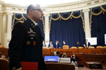National Security Council aide Lt. Col. Alexander Vindman departs after testifying before the House Intelligence Committee on Capitol Hill in Washington, Tuesday, Nov. 19, 2019, during a public impeachment hearing of President Donald Trump's efforts to tie U.S. aid for Ukraine to investigations of his political opponents. (AP Photo/Alex Brandon)
