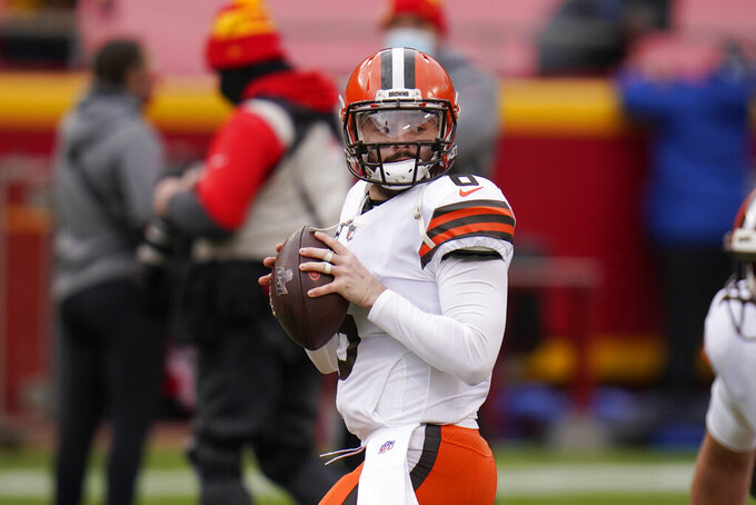 FILE - In this Sunday, Jan. 17, 2021, file photo, Cleveland Browns quarterback Baker Mayfield warms up before an NFL divisional round football game against the Kansas City Chiefs in Kansas City. Baker Mayfield has changed Cleveland. Coming off a solid third season and playoff appearance, Mayfield has brought much-needed comfort to the Browns, who entered 2020 still unsure if the No. 1 draft pick in was the answer but now feel confident they've got their guy. At last. (AP Photo/Jeff Roberson, File)
