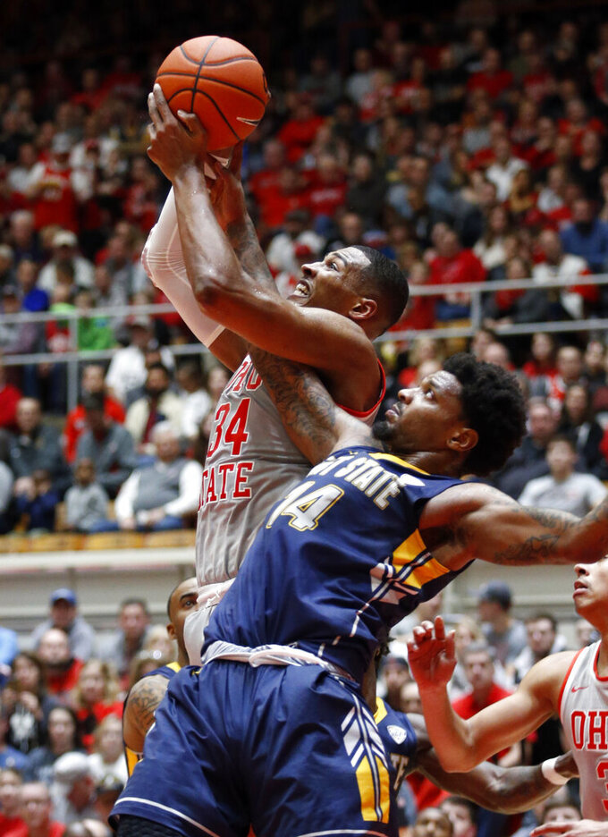 Ohio State forward Kaleb Wesson, top, pulls down a rebound against Kent State forward Tervell Beck during the first half of an NCAA college basketball game in Columbus, Ohio, Monday, Nov. 25, 2019. (AP Photo/Paul Vernon)