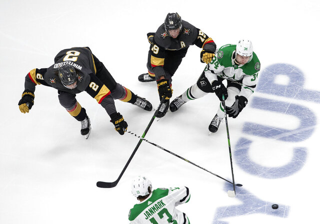 Dallas Stars' Denis Gurianov (34), Vegas Golden Knights' Reilly Smith (19) and Golden Knights' Zach Whitecloud (2) battle for the puck during third-period NHL Western Conference final playoff game action in Edmonton, Alberta, Monday, Sept. 14, 2020. (Jason Franson/The Canadian Press via AP)