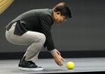 Hyun-Suk Kim, president and CEO of the Consumer Electronics Division at Samsung, demonstrates Ballie, an AI rolling robot during a Samsung keynote before the CES tech show, Monday, Jan. 6, 2020, in Las Vegas. (AP Photo/John Locher)