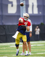 Quarterback Brendon Clark throws during Notre Dame NCAA college football practice in South Bend, Ind., Thursday, Aug. 12, 2021. (Michael Caterina/South Bend Tribune via AP)