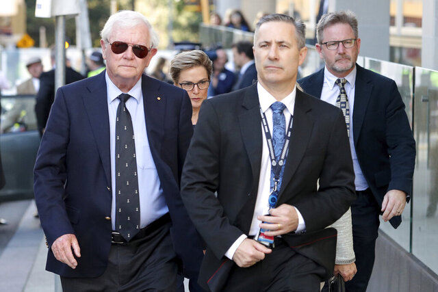 Denis Glennon, left, father of Ciara Glennon, arrives at the Supreme Court of Western Australia in Perth, Thursday, Sept. 24, 2020. A judge found a man guilty of murdering two women but not guilty of murdering a third in crimes that terrorised the Australian city of Perth in the late 1990s. Sarah Spiers, 18, Jane Rimmer, 23, and Ciara Glennon, 27, vanished after nights out with friends in the up-market Claremont nightlife precinct in 1996 and 1997. (Richard Wainwright/AAP Image via AP)