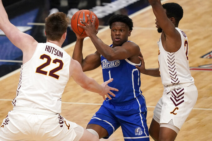 Drake's Joseph Yesufu (1) looks to pass as Loyola of Chicago's Jacob Hutson (22) and Marquise Kennedy defend during the first half of the championship game in the NCAA Missouri Valley Conference men's basketball tournament Sunday, March 7, 2021, in St. Louis. (AP Photo/Jeff Roberson)