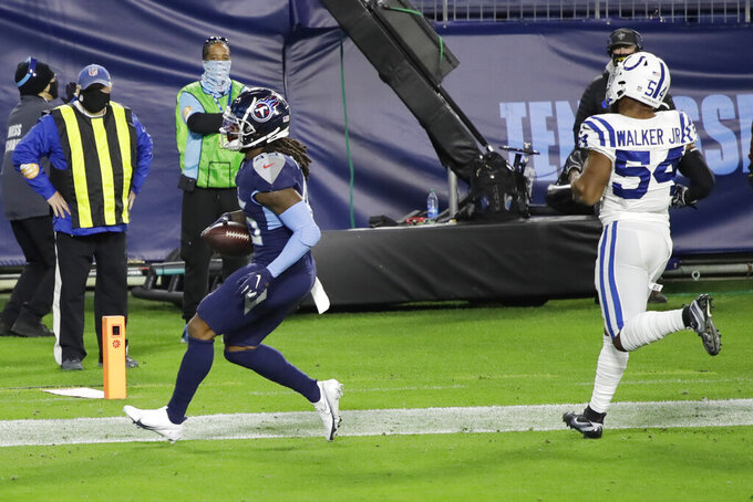 Tennessee Titans running back D'Onta Foreman (45) scores a touchdown ahead of Indianapolis Colts middle linebacker Anthony Walker (54) in the first half of an NFL football game Thursday, Nov. 12, 2020, in Nashville, Tenn. (AP Photo/Ben Margot)