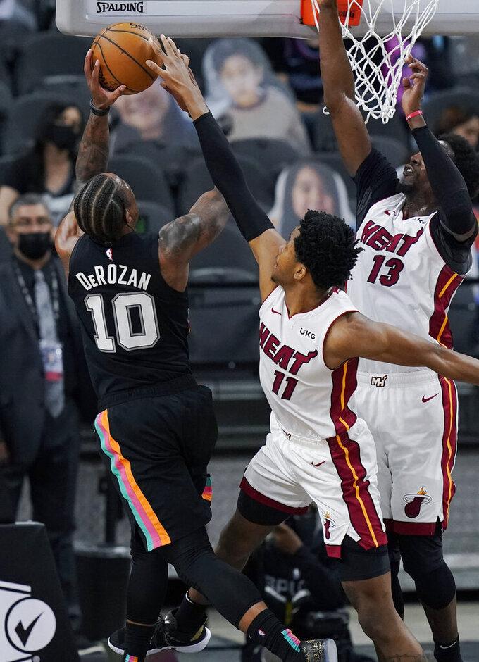 San Antonio Spurs forward DeMar DeRozan (10) is blocked by Miami Heat forward KZ Okpala (11) during the second half of an NBA basketball game in San Antonio, Wednesday, April 21, 2021. (AP Photo/Eric Gay)