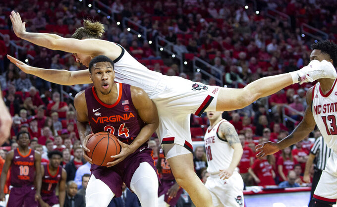 Virginia Tech's Kerry Blackshear Jr. (24) is fouled by North Carolina State's Wyatt Walker, right, during the second half of an NCAA college basketball game in Raleigh, N.C., Saturday, Feb. 2, 2019. (AP Photo/Ben McKeown)