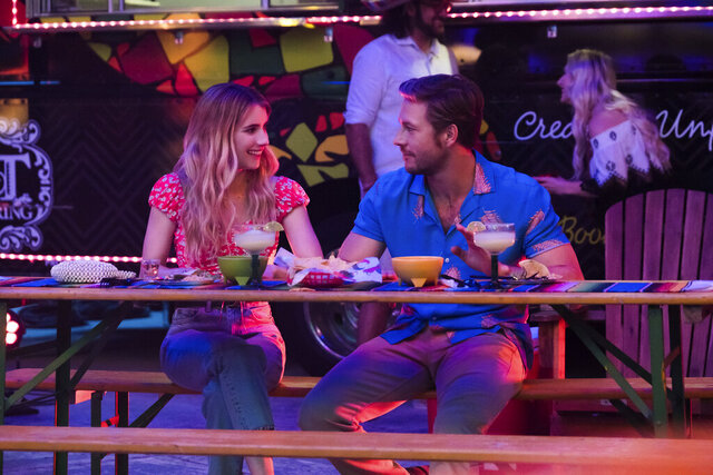 This image released by Netflix shows Emma Roberts and Luke Bracey, right, in a scene from