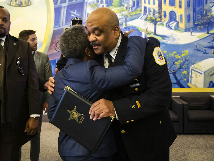 Chicago Police Department Supt. Eddie Johnson hugs Mayor Lori Lightfoot after he announced his retirement during a press conference at CPD headquarters, Thursday morning, Nov. 7, 2019. (Ashlee Rezin Garcia/Chicago Sun-Times via AP)