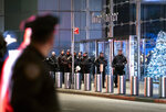 New York City police officers walk near the Time Warner Center Thursday, Dec. 6, 2018, after a bomb threat was called into the building and occupants were evacuated, including CNN employees. Police have given the all-clear after a phoned in bomb threat forced the evacuation of CNN's offices in New York. (AP Photo/Craig Ruttle)