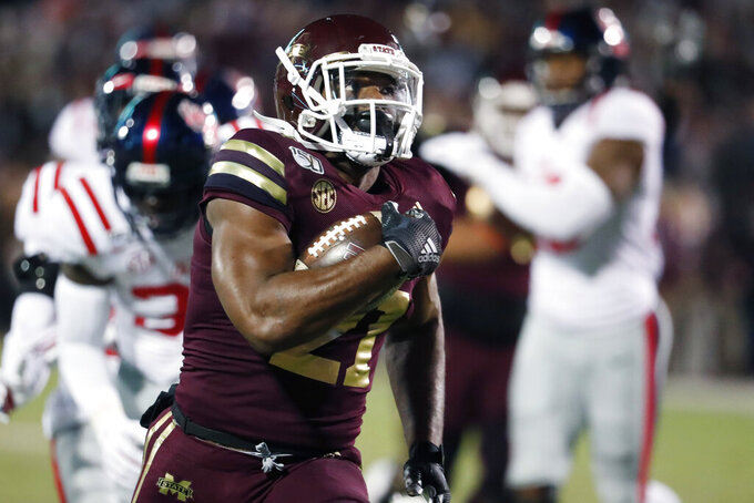Mississippi State running back Nick Gibson (21) runs for a 27-yard touchdown against Mississippi during the first half of an NCAA college football game in Starkville, Miss., Thursday, Nov. 28, 2019. (AP Photo/Rogelio V. Solis)