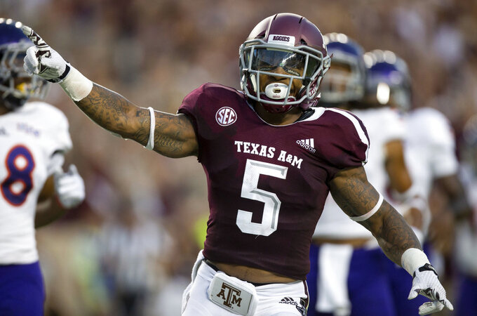 Texas A&M running back Trayveon Williams (5) gestures after scoring on a 73-yard run during the first half of an NCAA college football game against Northwestern State Thursday, Aug. 30, 2018, in College Station, Texas. (AP Photo/Sam Craft)