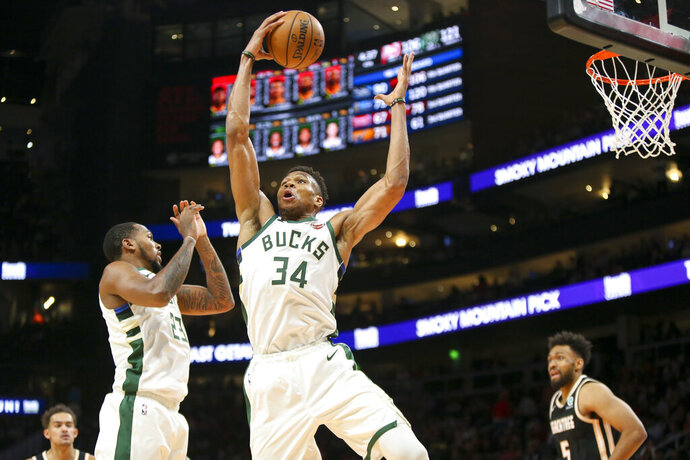Milwaukee Bucks forward Giannis Antetokounmpo (34) grabs a rebound against the Atlanta Hawks in the second half of an NBA basketball game, Wednesday, Nov. 20, 2019, in Atlanta. (AP Photo/Brett Davis)