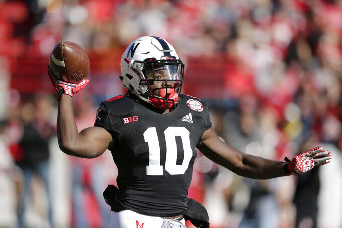 Nebraska wide receiver JD Spielman (10) throws a pass during the first half of an NCAA college football game against Indiana in Lincoln, Neb., Saturday, Oct. 26, 2019. (AP Photo/Nati Harnik)