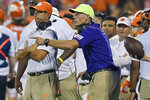 Clemson head coach Dabo Swinney, left, and defensive coach Brent Venables talk during an NCAA college football game against Georgia Tech, in Clemson, S.C., Thursday, Aug. 29, 2019. Venables has overseen Clemson's defensive rise that's dovetailed with its dominance in college football. The Tigers have won five straight Atlantic Coast Conference championships and national titles after the 2016 and 2018 seasons. (AP Photo/Richard Shiro, File)